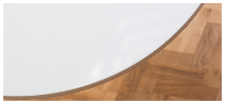 Close up view of the surface of the white laminate Tulip Table top