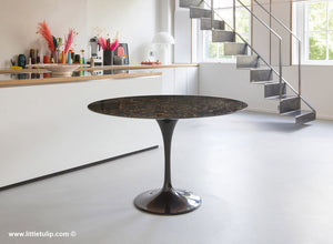 The 120cm Saarinen Tulip Table in Black marble is the perfect size of parties of four or six