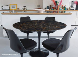 Gorgeous Portoro Marble Tulip Dining Set offset with luxurious black cushions