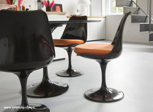 The 120cm Black Tulip dining set has Marble table and 4 side chairs with orange cushions