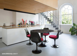 Industrial uplift with the amazing Tulip dining set in 120cm Portoro Black marble and chairs with red cushions