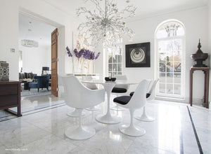 Spectacular dining room with round marble tulip table and 6 tulip chairs in black