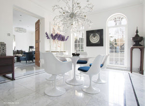Spectacular dining room with round marble tulip table and 6 tulip chairs in blue