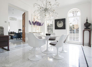 Spectacular dining room with round marble tulip table and 6 tulip chairs in grey