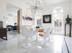 Spectacular dining room with round marble tulip table and 6 tulip chairs in orange