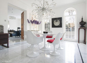 Spectacular dining room with round marble tulip table and 6 tulip chairs in red