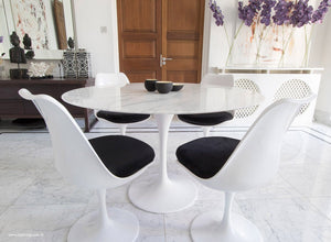 Main view of 120cm marble Tulip table, 4 tulip side chairs with black cushions