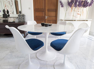 Main view of 120cm marble Tulip table, 4 tulip side chairs with blue cushions
