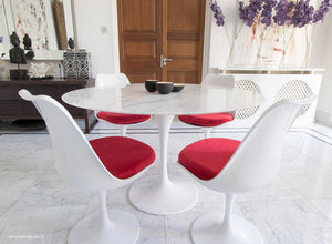Main view of 120cm marble Tulip table, 4 tulip side chairs with red cushions