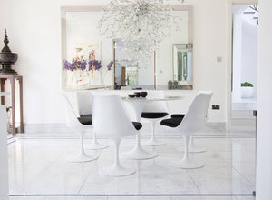 Circular marble Tulip Table and six Tulip Chairs with black cushions