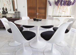 Close up of Tulip Table in marble & matching Tulip Chairs in black