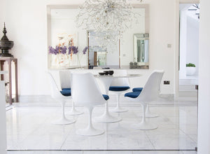 Circular marble Tulip Table and six Tulip Chairs with blue cushions