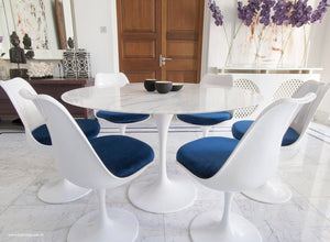 Close up of Tulip Table in marble & matching Tulip Chairs in blue