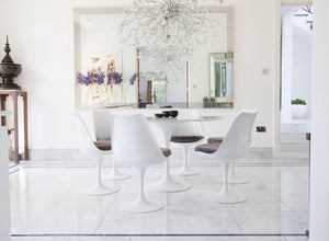 Circular marble Tulip Table and six Tulip Chairs with grey cushions