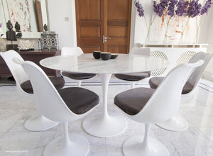 Close up of Tulip Table in marble & matching Tulip Chairs in grey