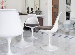 Tulip Chair with a grey cushion in dining room with marble floor
