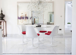 Circular marble Tulip Table and six Tulip Chairs with red cushions