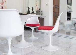 Tulip Chair with a red cushion in dining room with marble floor