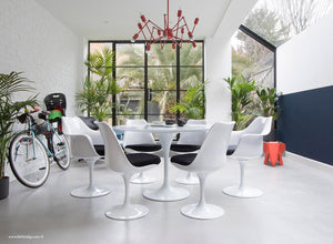 Room view of 120cm & 6 Tulip Chairs with black cushions