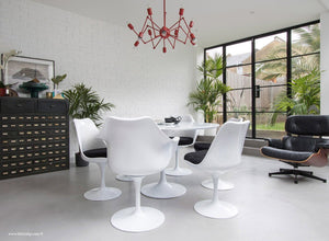 Side view of Tulip table set with 6 chairs in black cushions