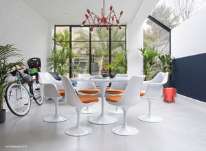 Room view of 120cm & 6 Tulip Chairs with orange cushions