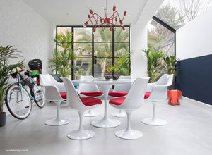 Room view of 120cm & 6 Tulip Chairs with red cushions