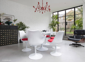 Side view of Tulip table set with 6 chairs in red cushions