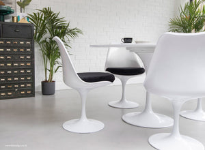 The Eero Saarinen Tulip Side Chair with a black fitted cushion