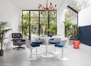 Orangery with Eames Lounge Chair, Tulip Dining Set with blue cushions