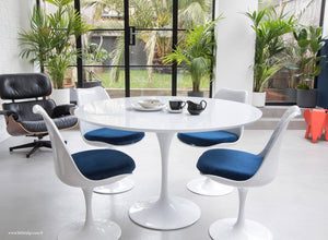 The white laminate Tulip Table with a 120cm top with 4 matching side chairs in blue