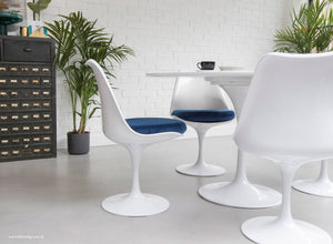 The Eero Saarinen Tulip Side Chair with a blue fitted cushion