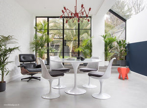 Orangery with Eames Lounge Chair, Tulip Dining Set with grey cushions
