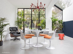 Orangery with Eames Lounge Chair, Tulip Dining Set with orange cushions