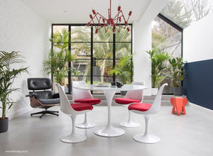 Orangery with Eames Lounge Chair, Tulip Dining Set with red cushions