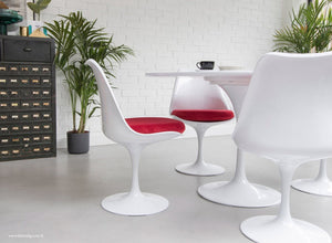 The Eero Saarinen Tulip Side Chair with a red fitted cushion