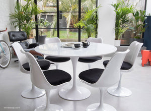 120cm White Tulip Table main view with 6 matching chairs with black cushions