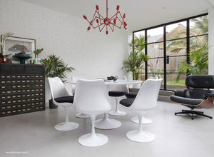 Orangery with Eames Chair, Chandelier, table and chairs with black cushions