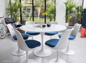 120cm White Tulip Table main view with 6 matching chairs with blue cushions