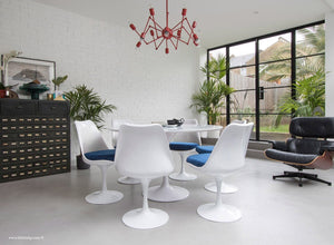 Orangery with Eames Chair, Chandelier, table and chairs with blue cushions