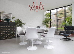 Orangery with Eames Chair, Chandelier, table and chairs with grey cushions