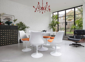 Orangery with Eames Chair, Chandelier, table and chairs with orange cushions