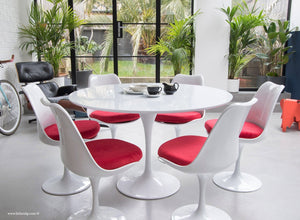 120cm White Tulip Table main view with 6 matching chairs with red cushions