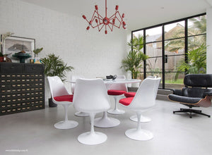 Orangery with Eames Chair, Chandelier, table and chairs with red cushions