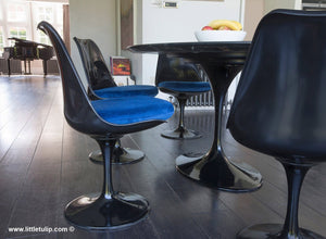 Black dining set includes 6 of the Tulip Side Chairs with fitted blue velvet like cushions