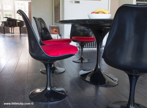 Black dining set includes 6 of the Tulip Side Chairs with fitted red velvet like cushions