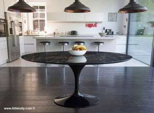 The 170 cm Oval Tulip Table in black marble is the perfect choice for the modern home