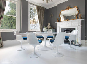 blue cushioned tulip side and arm chairs with a 170cm oval marble table