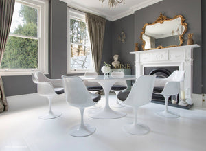 grey cushioned tulip side and arm chairs with a 170cm oval marble table