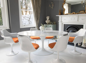 170cm dining set with 6 matching tulip chairs with orange cushions