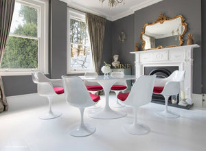 red cushioned tulip side and arm chairs with a 170cm oval marble table